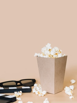 Close-up popcorn box with 3d glasses on the table