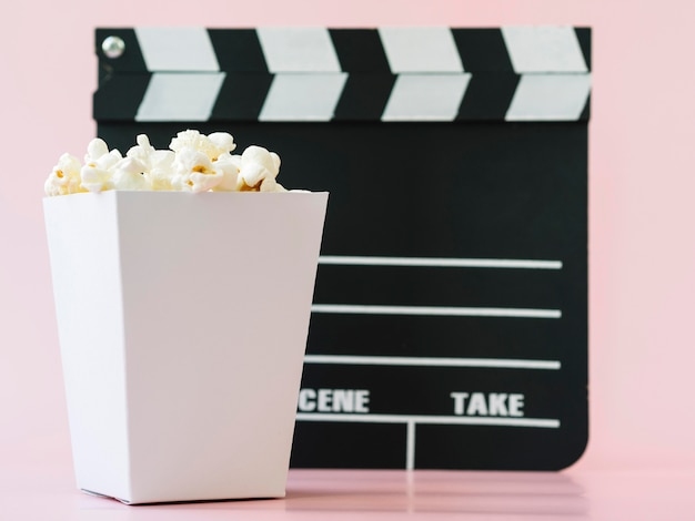 Close-up popcorn box with clapperboard