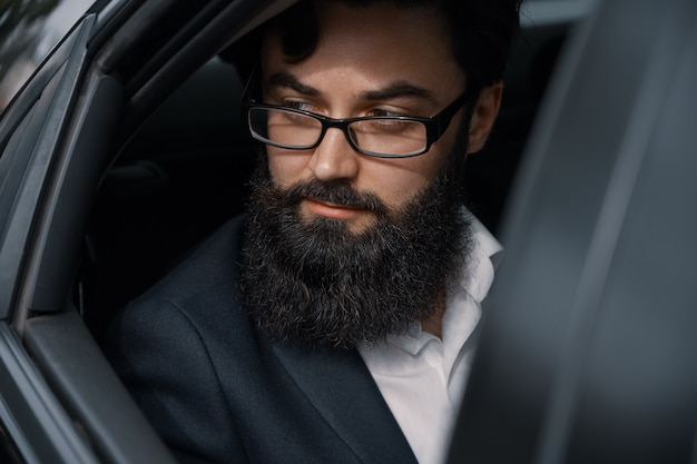 Close up portrair attractive young businessman in a car