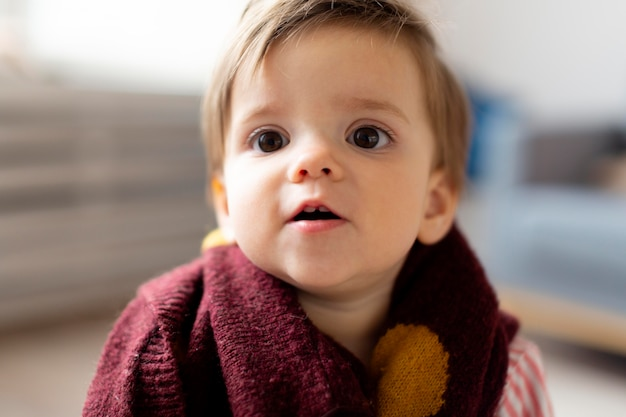 Close-up portrait of adorable baby at home