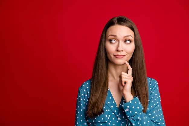 Close-up portrait of attractive minded girl overthinking copy empty space place isolated on bright red color background