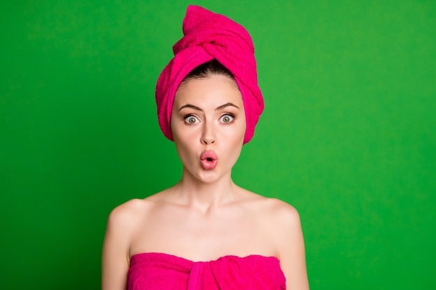 Close-up portrait of attractive naked nude amazed lady wearing turban taking pout lips spa therapy isolated on bright green color background