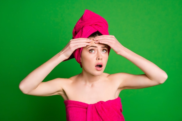 Close-up portrait of attractive worried nervous lady wearing turban touching forehead isolated on bright green color background