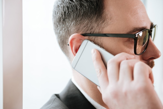 Close up portrait of bearded business man talking on phone