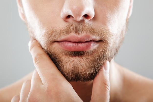 Close up portrait of bearded half men's face