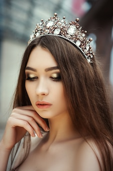 Close up portrait of a beautiful girl with a  crown