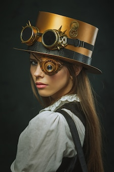 Close-up portrait of a beautiful woman steampunk, hat and eyecup.