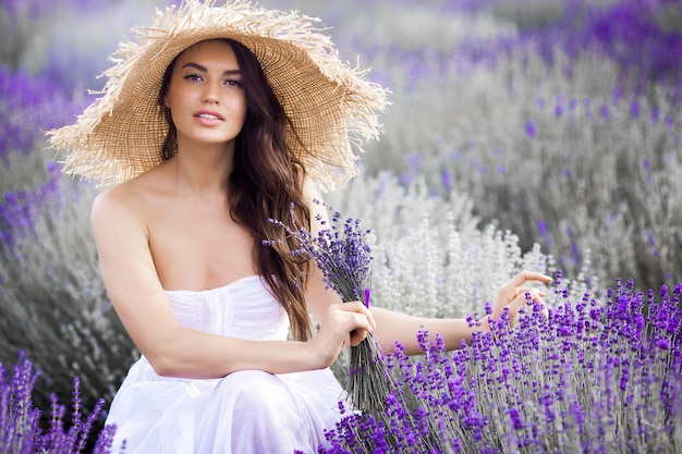 Close up portrait of beautiful young woman in lavender field.