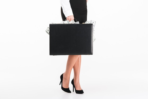 Close up portrait of a businesswoman holding briefcase