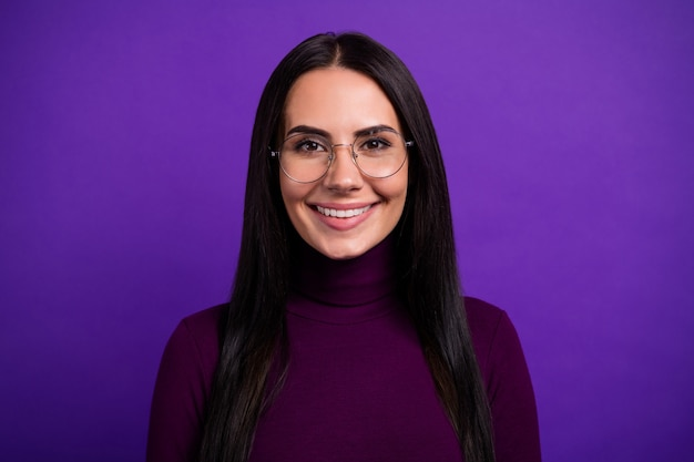 Close up portrait of cheerful woman with specs with pleasure isolated vibrant color purple wall