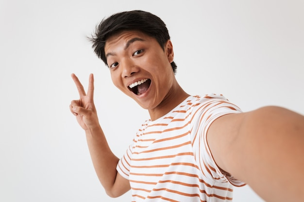 Close up portrait of a cheerful young asian man