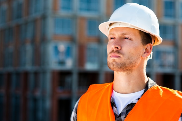 Close-up portrait of construction engineer looking away
