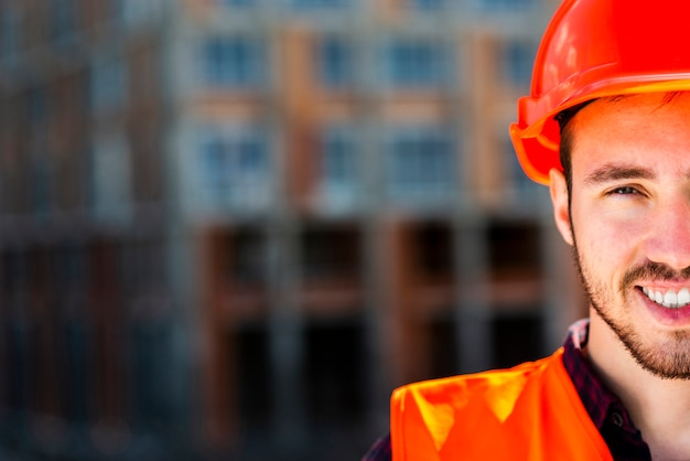 Close up portrait of construction worker looking at camera