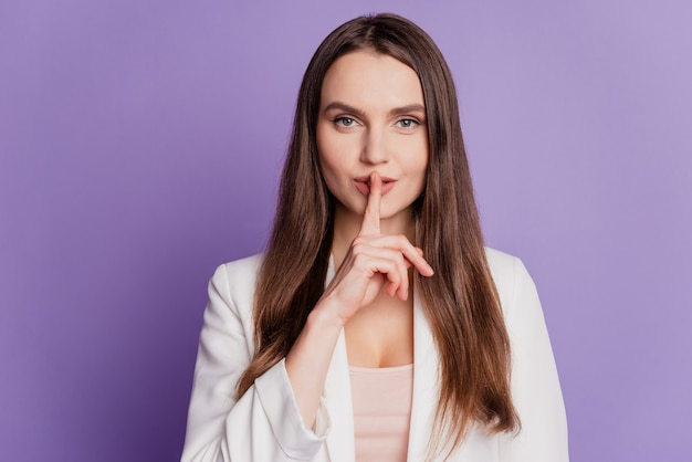 Close up portrait of cunning flirty lady finger lips wear formal suit posing on violet wall