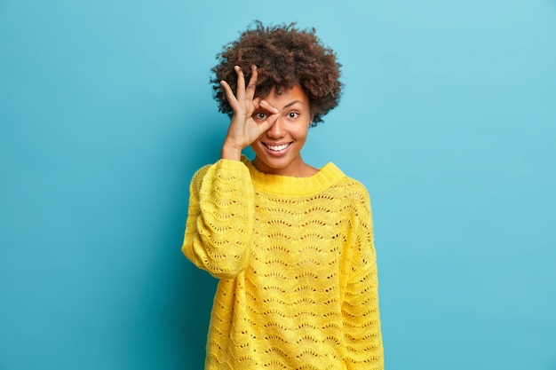 Close up portrait of curly haired young woman isolated