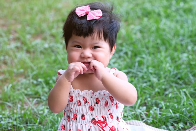 Close up portrait of a cute asian baby girl.