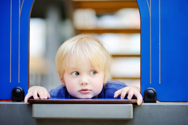 Close-up portrait of cute little boy during game