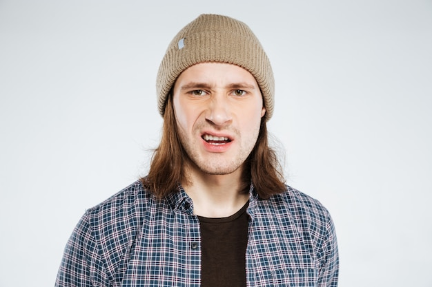Close up portrait of displeased hipster
