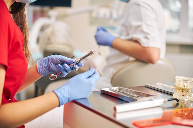 Close up portrait of doctor holding in her dentist hand carpool syringe for local anesthesia