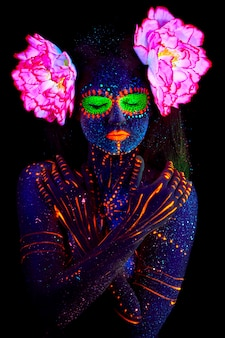 Close-up portrait, ethnic prints on skin, glowing on neon lights.