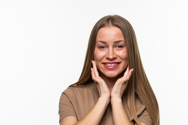 Close up portrait of an excited smiling woman isolated over white surface