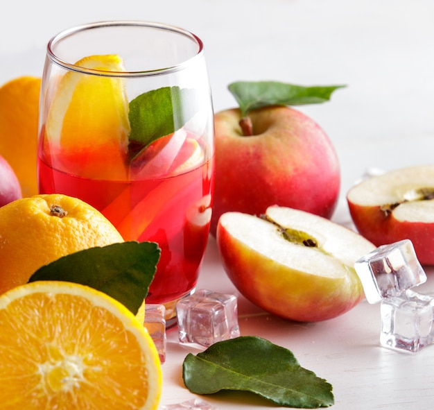 Close up portrait of fresh mix syrup with orange and apple slice