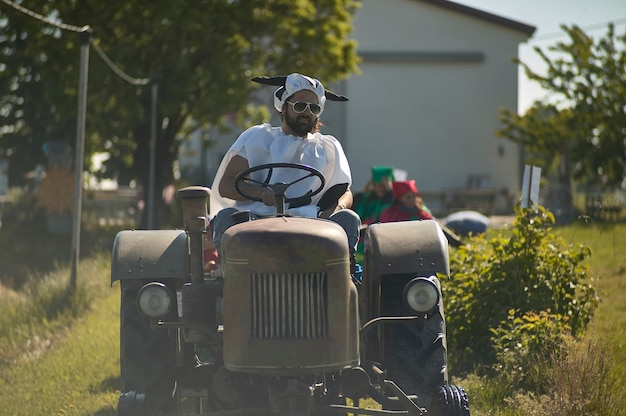 Close up portrait of funny farmer on the tractor