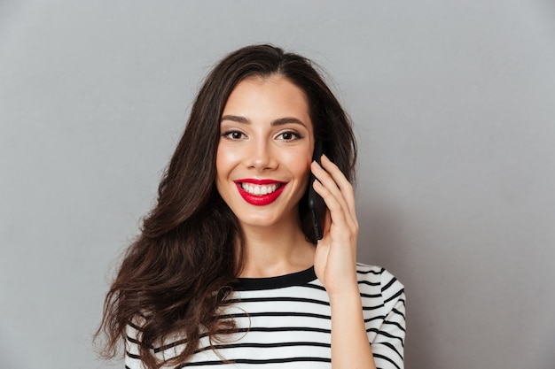 Close up portrait of a girl talking on mobile phone