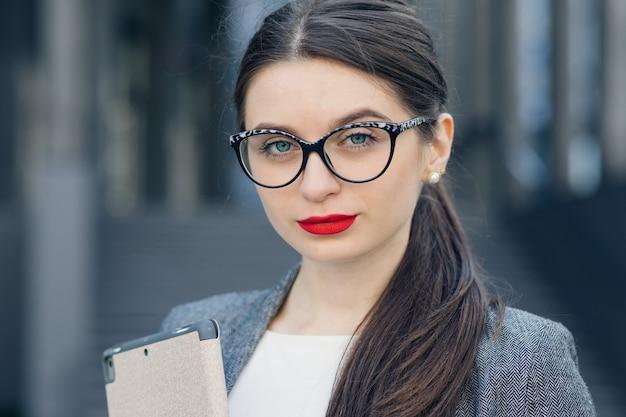 Close-up portrait of a gorgeous young woman wearing glasses. beauty, fashion. make-up. optics, eyewear. portrait of young businesswoman wearing glasses