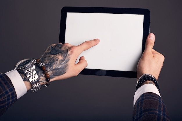 Close-up portrait of hands with digital tablet