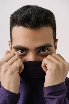 Close up portrait of handsome african american man wearing stylish purple turtleneck, posing for pictures