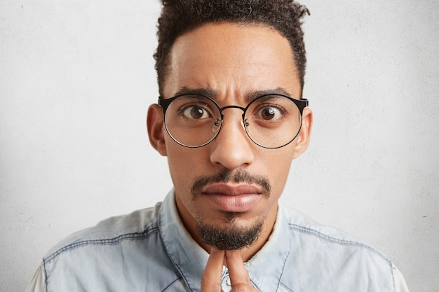 Close up portrait of handsome fashionable young mixed race male with oval face