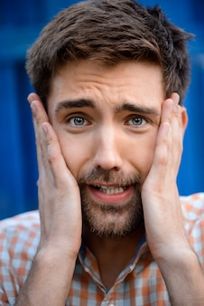 Close up portrait of handsome man upset
