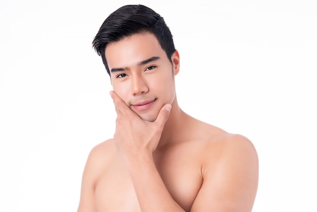 Close up portrait of handsome young asian man on white background,