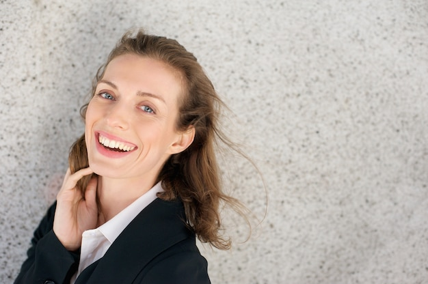 Close up portrait of a happy business woman laughing expressing positivity