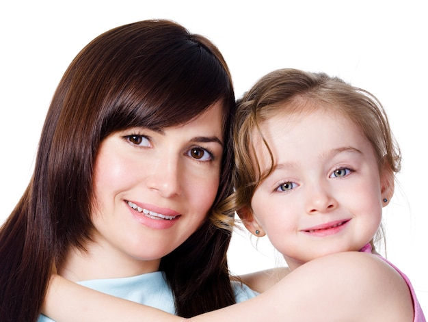 Close-up portrait of happy family of beautiful mother with daughter - white space