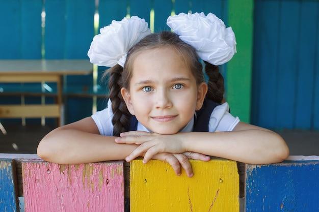 Close-up portrait of happy little schoolgirl