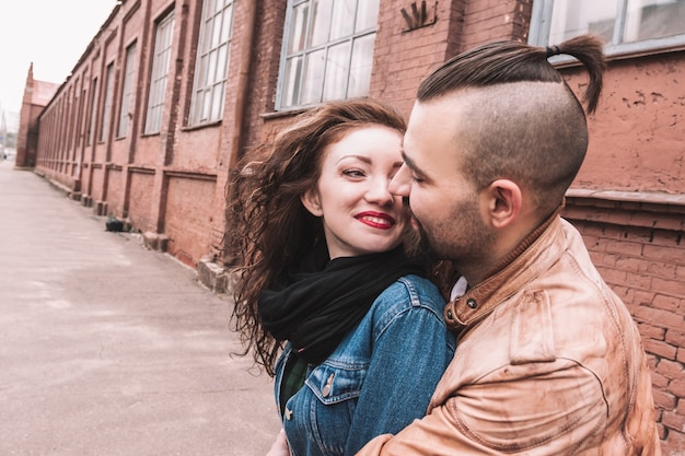 Close up. portrait of a happy loving couple on the background of an old city building.