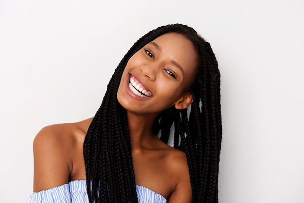 Close up portrait of happy young black woman with braided hair laughing