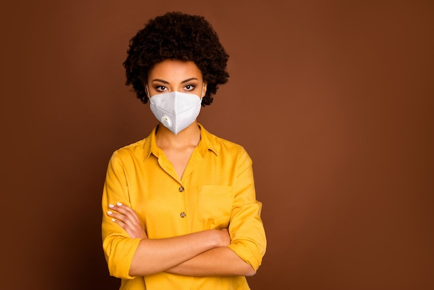 Close-up portrait of her she attractive healthy girl wearing respirator safety mask stop viral pneumonia air pollution co2 china wuhan problem syndrome isolated brown color background