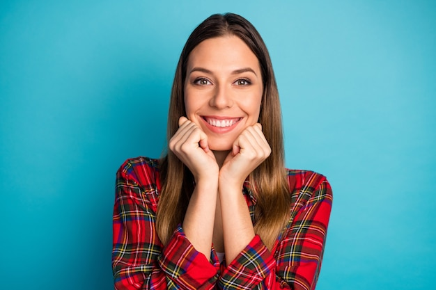 Close-up portrait of her she nice attractive lovely lovable cute winsome cheerful cheery girl wearing checked shirt enjoying isolated on bright vivid shine vibrant blue color background