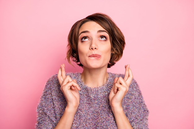 Close-up portrait of her she nice attractive lovely pretty charming girlish cheerful brown-haired girl asking miracle fairy crossed fingers reaction isolated over pink pastel color wall