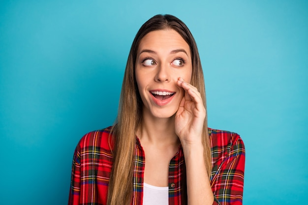 Close-up portrait of her she nice attractive lovely pretty girlish cheerful cheery girl wearing checked shirt saying good news isolated on bright vivid shine vibrant blue color background