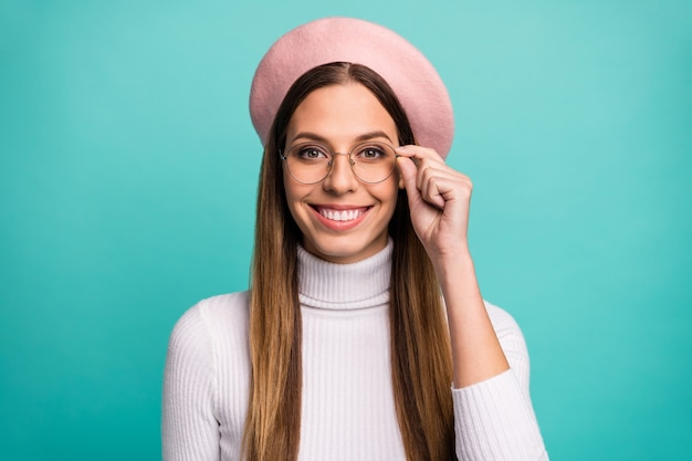 Close-up portrait of her she nice attractive lovely pretty intellectual content cheerful cheery straight-haired girl touching specs isolated over bright vivid shine vibrant blue color background