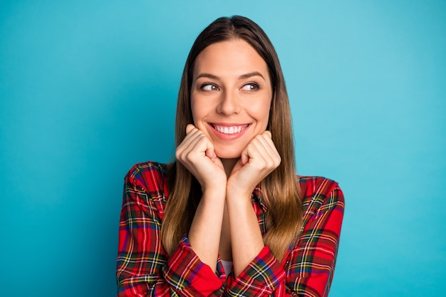 Close-up portrait of her she nice attractive lovely pretty lovable cute cheerful cheery girl wearing checked shirt dreaming looking aside isolated on bright vivid shine vibrant blue color background