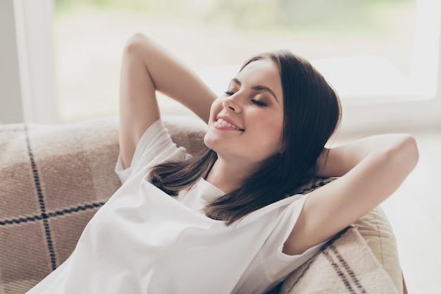 Close-up portrait of her she nice attractive pretty dreamy cheery brown-haired girl lying on bed sofa enjoying good morning awakening resting in light house indoors