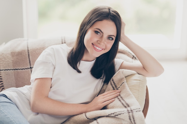 Close-up portrait of her she nice attractive pretty healthy cheerful cheery brown-haired girl lying on bed sofa resting homey comfort life dream in light house indoors