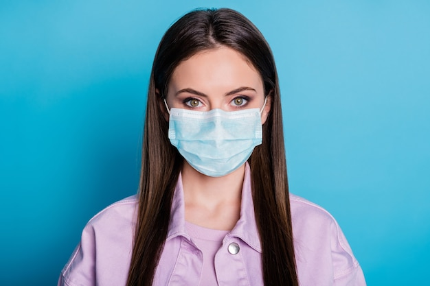 Close-up portrait of her she nice attractive pretty healthy girl wearing gauze safety mask stop influenza flu flue grippe viral pneumonia isolated bright vivid shine vibrant blue color background