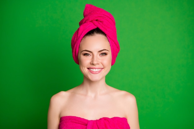 Close-up portrait of her she nice cheerful healthy lady wearing pink towel turban on head isolated over vibrant green color background