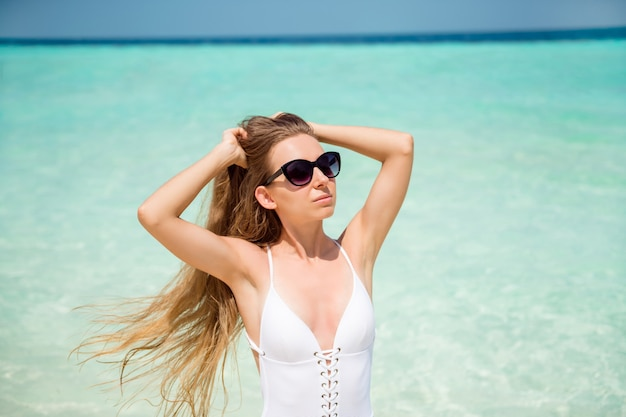 Close-up portrait of her she nice-looking alluring attractive healthy lady resting famous luxury wellness resort international destination enjoying sunny hot weather azure sea turkey fresh air
